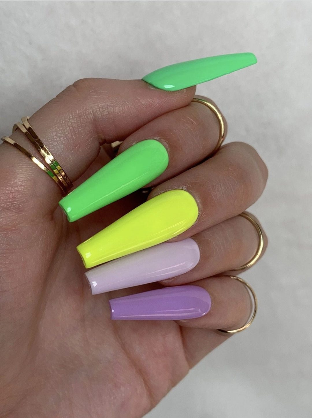 Neon and pastel gradient nails with green, yellow and purple tones