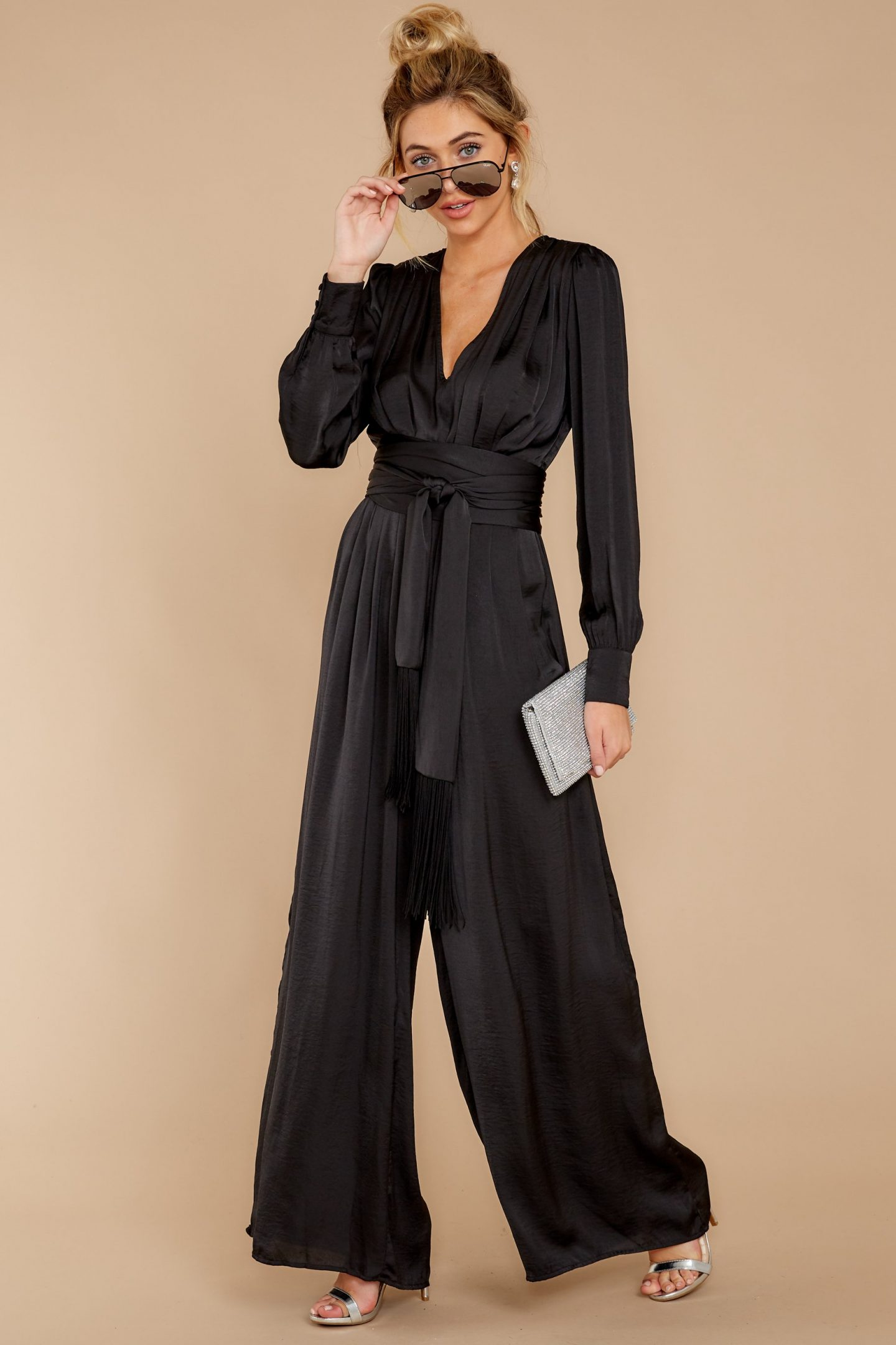 Black satin jumpsuit with long sleeves