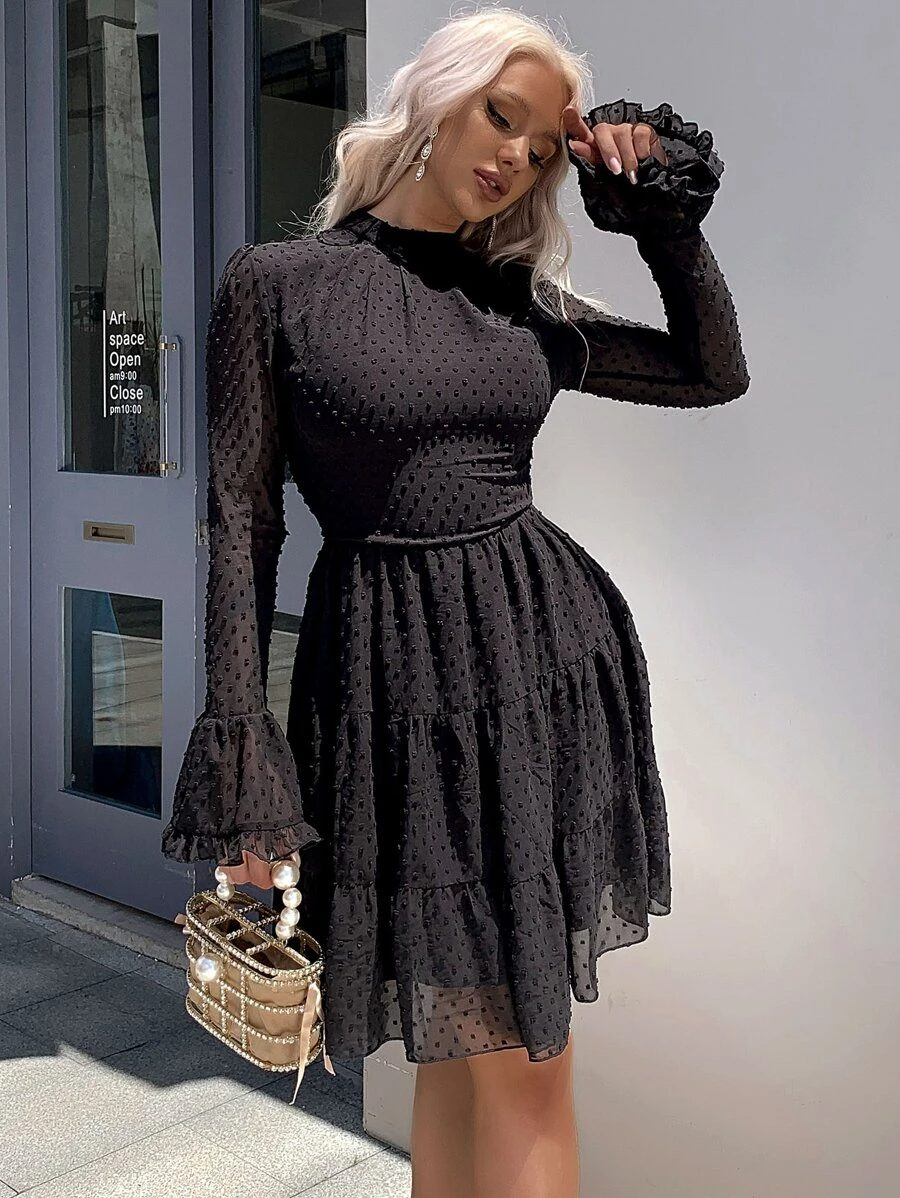 Black tulle dress with ruffles and long sleeves