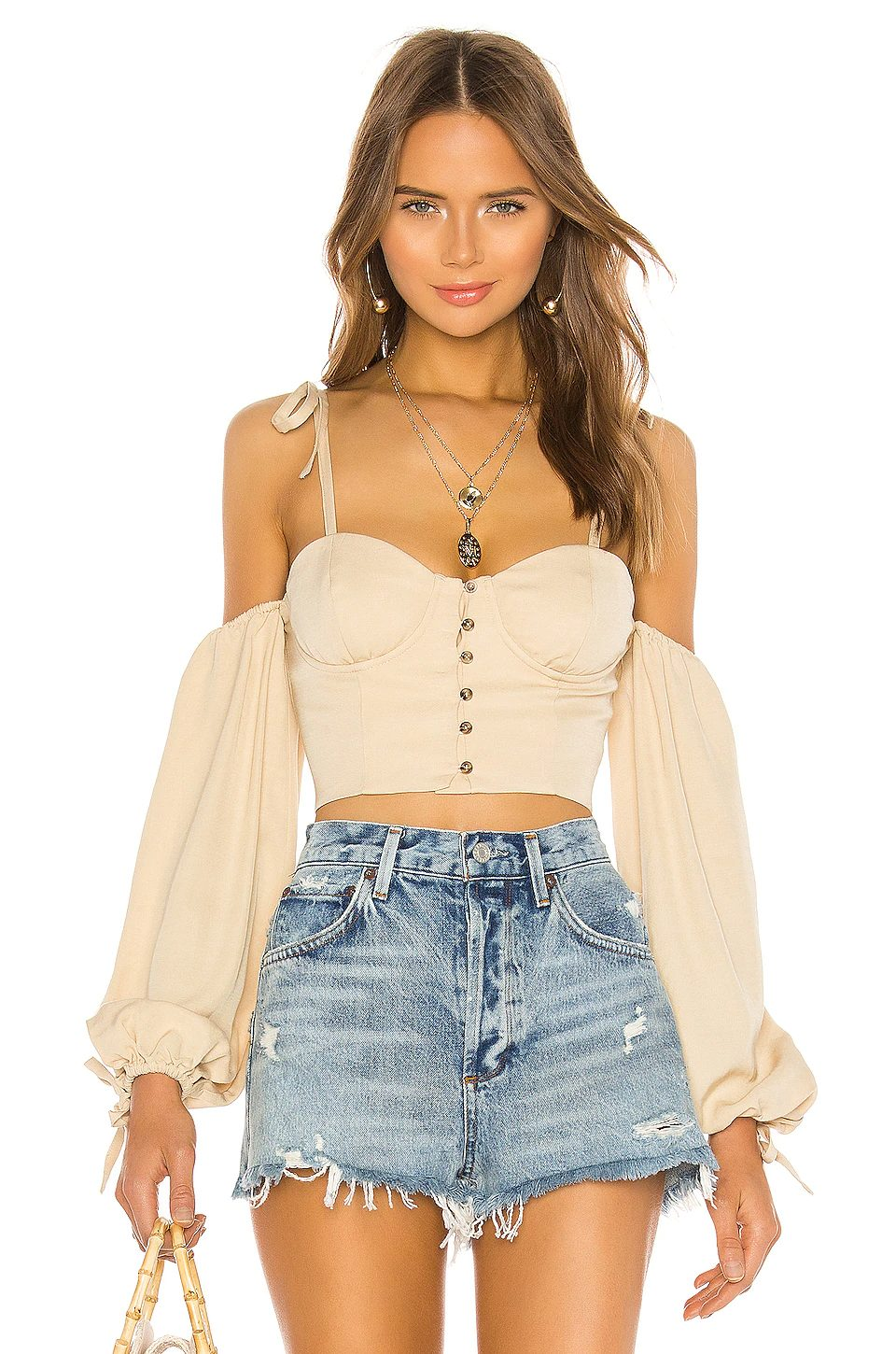 Cute and casual summer outfit with shorts and corset top