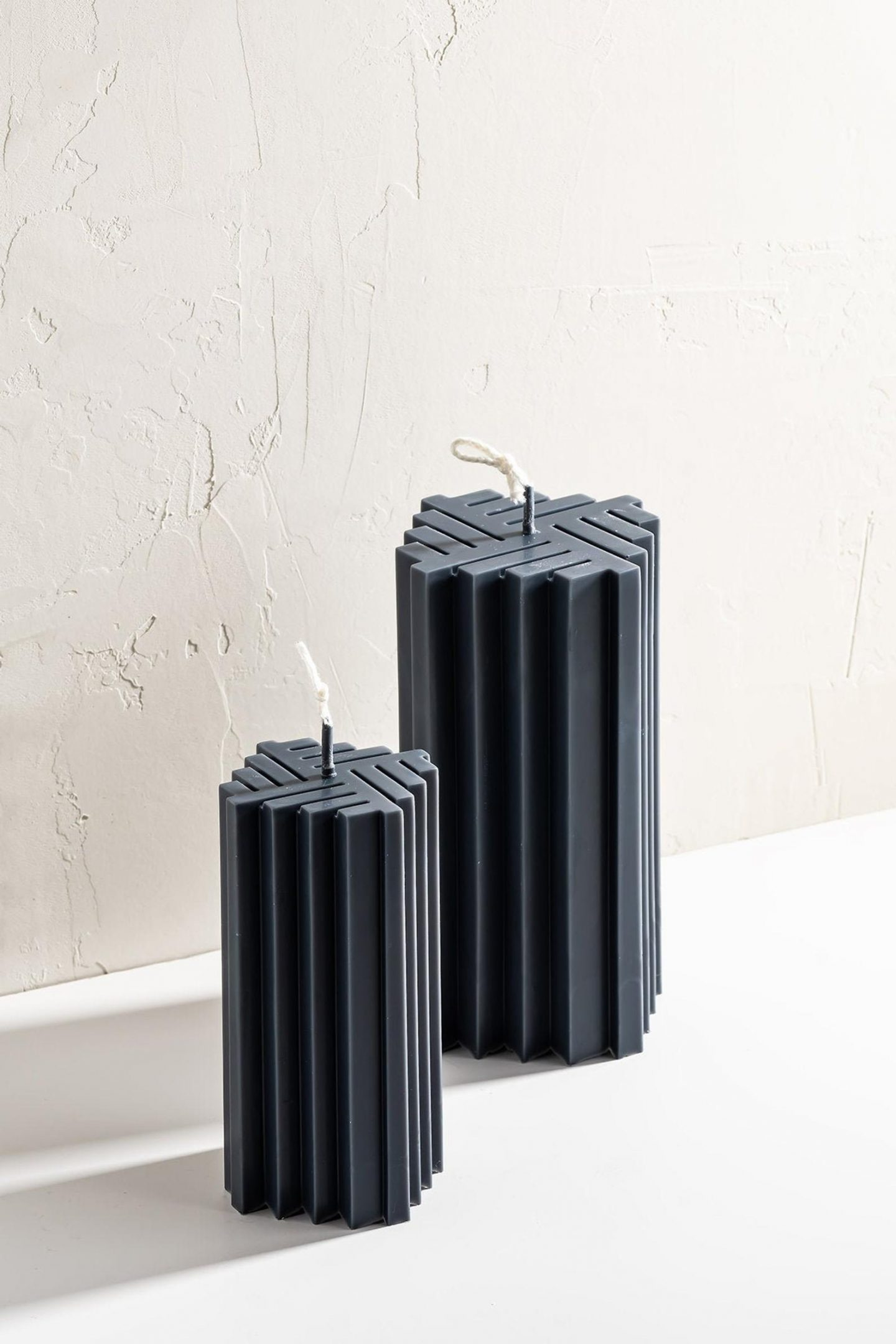 Trendy black accordion pillar candle