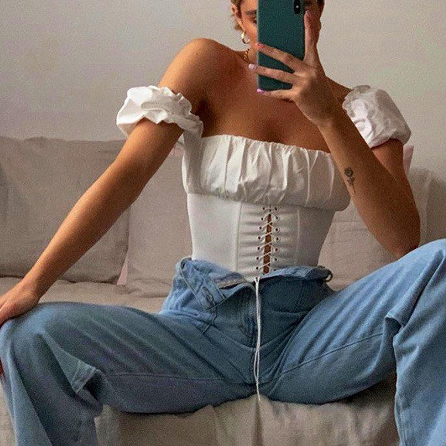Cute casual white corset top outfit with jeans