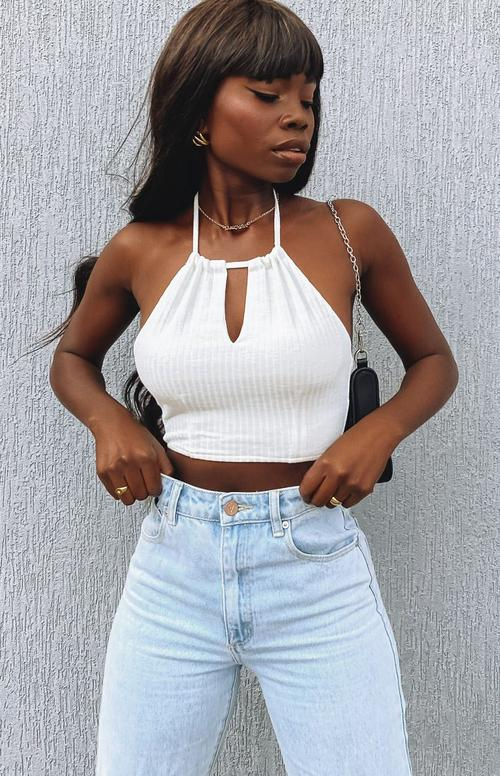 Cute white crop top outfit with jeans