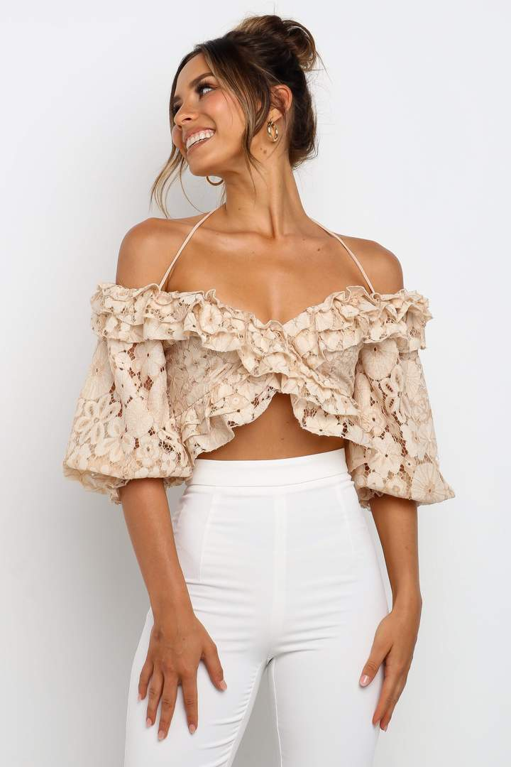 Beige lace crop top outfit with white pants