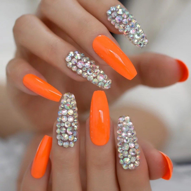 Neon orange coffin nails with rhinestones