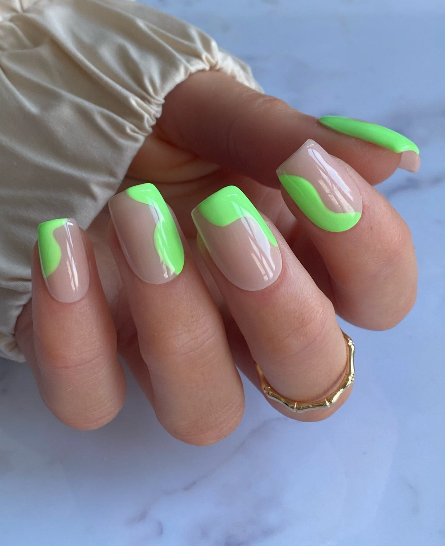 Neon green abstract nails with swirls