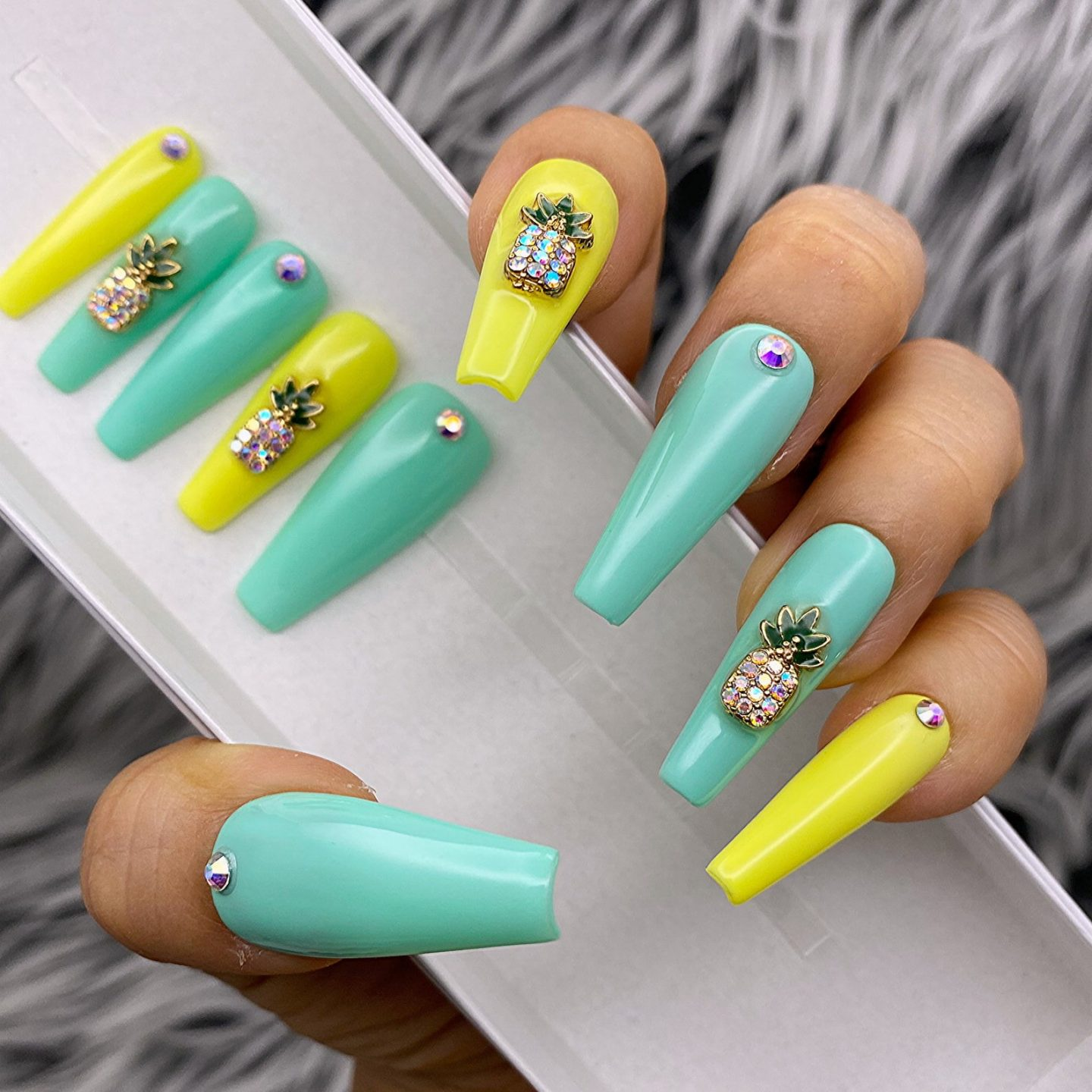 Yellow and mint green coffin nails with pineapple nail art