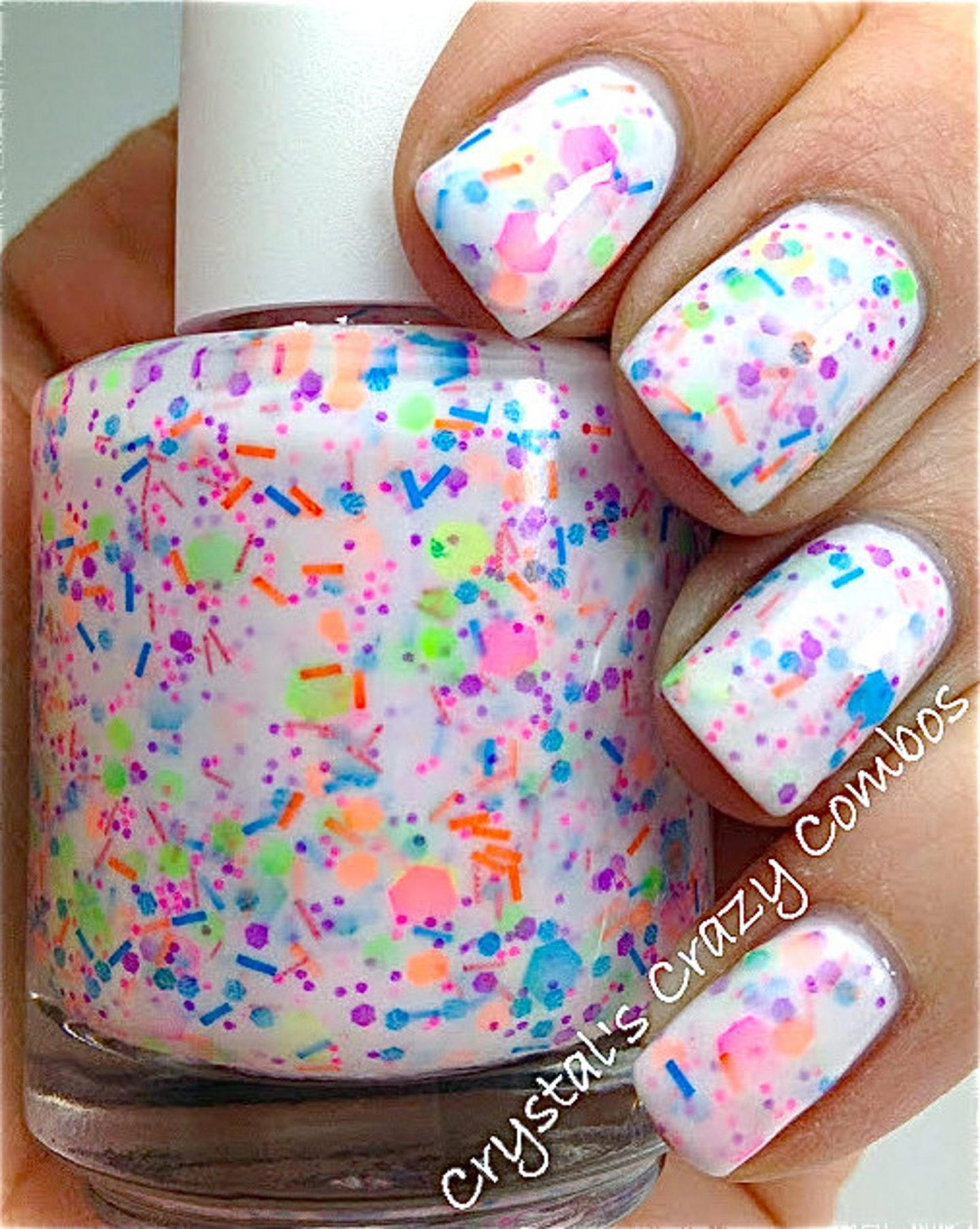 Short white nails with neon splatters