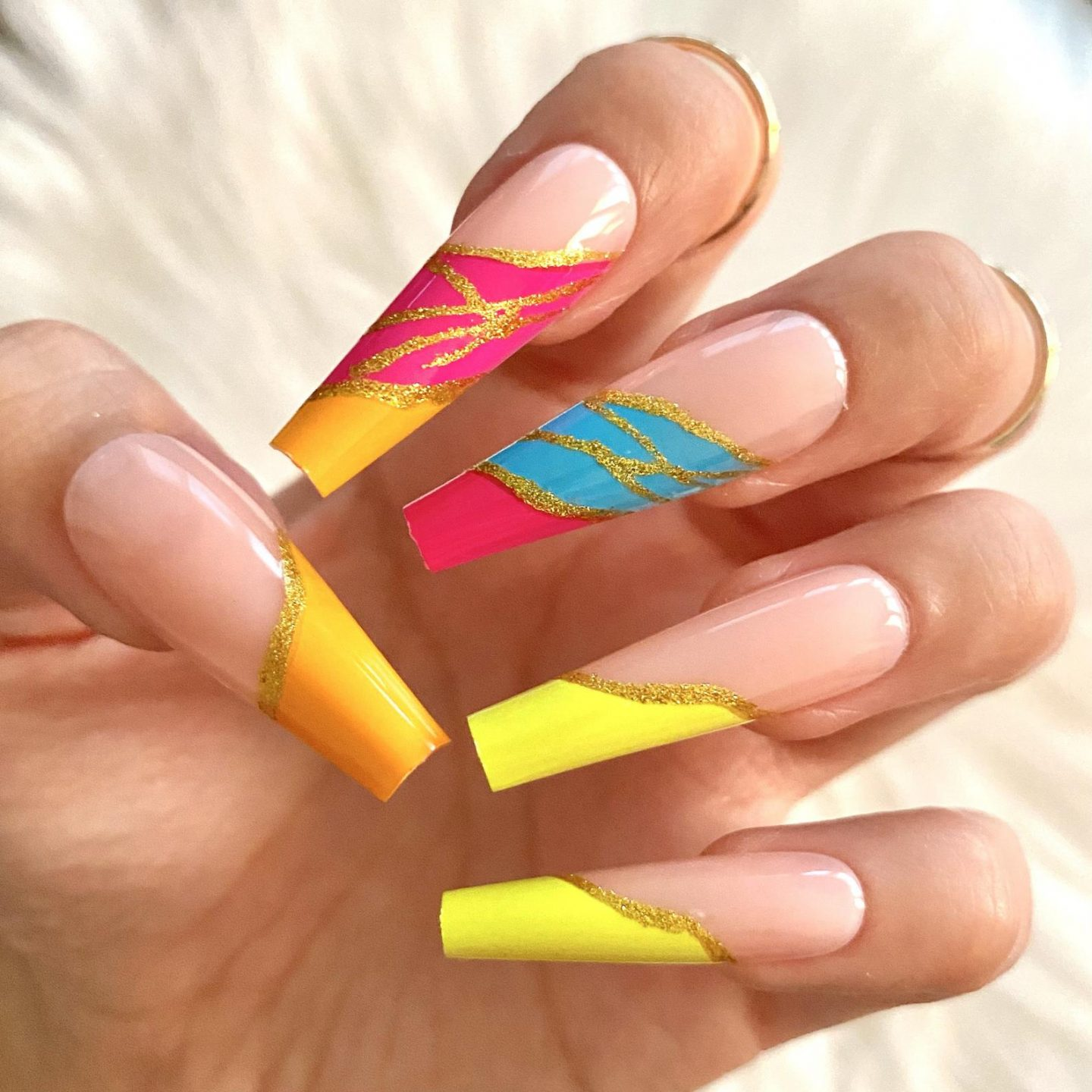 Neon yellow, blue and red coffin nails with gold glitter