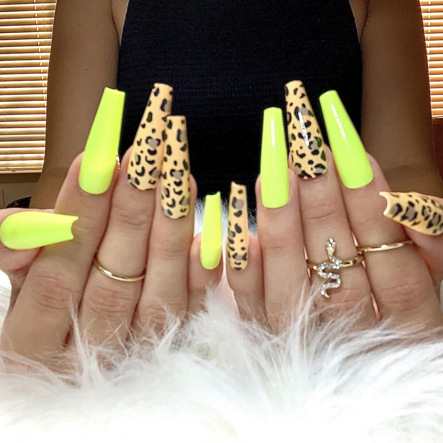 Neon yellow nails with leopard print nail art