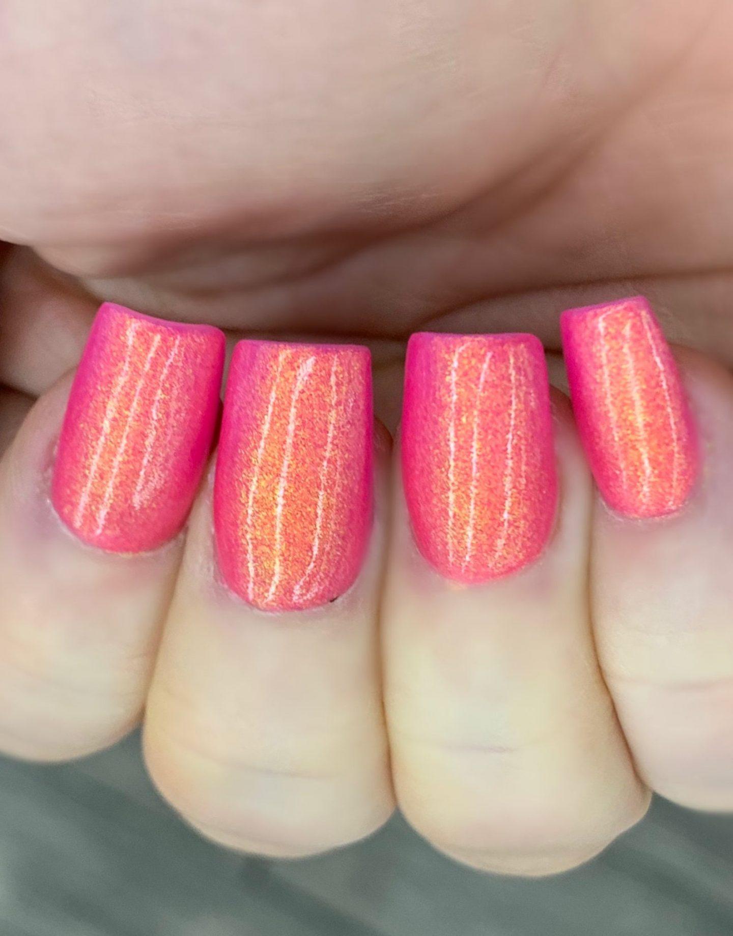 Holographic pink and orange nail polish