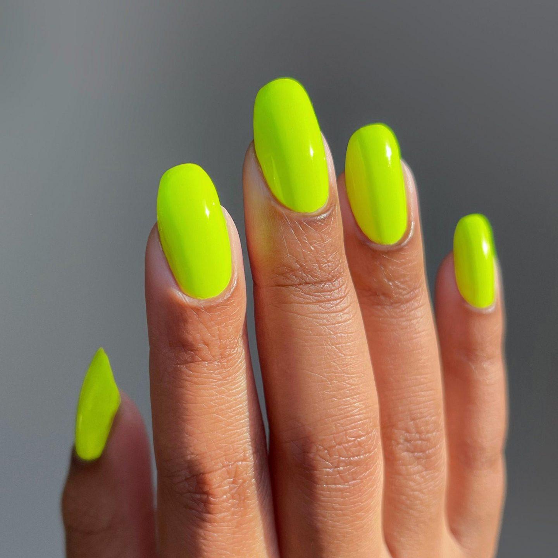 Neon yellow nail polish on short nails