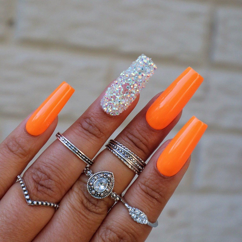 Neon orange coffin nails with glitter