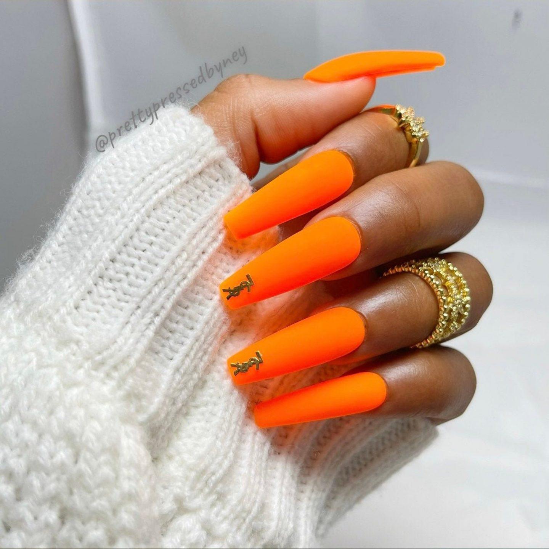Neon orange coffin nails with YSL nail art