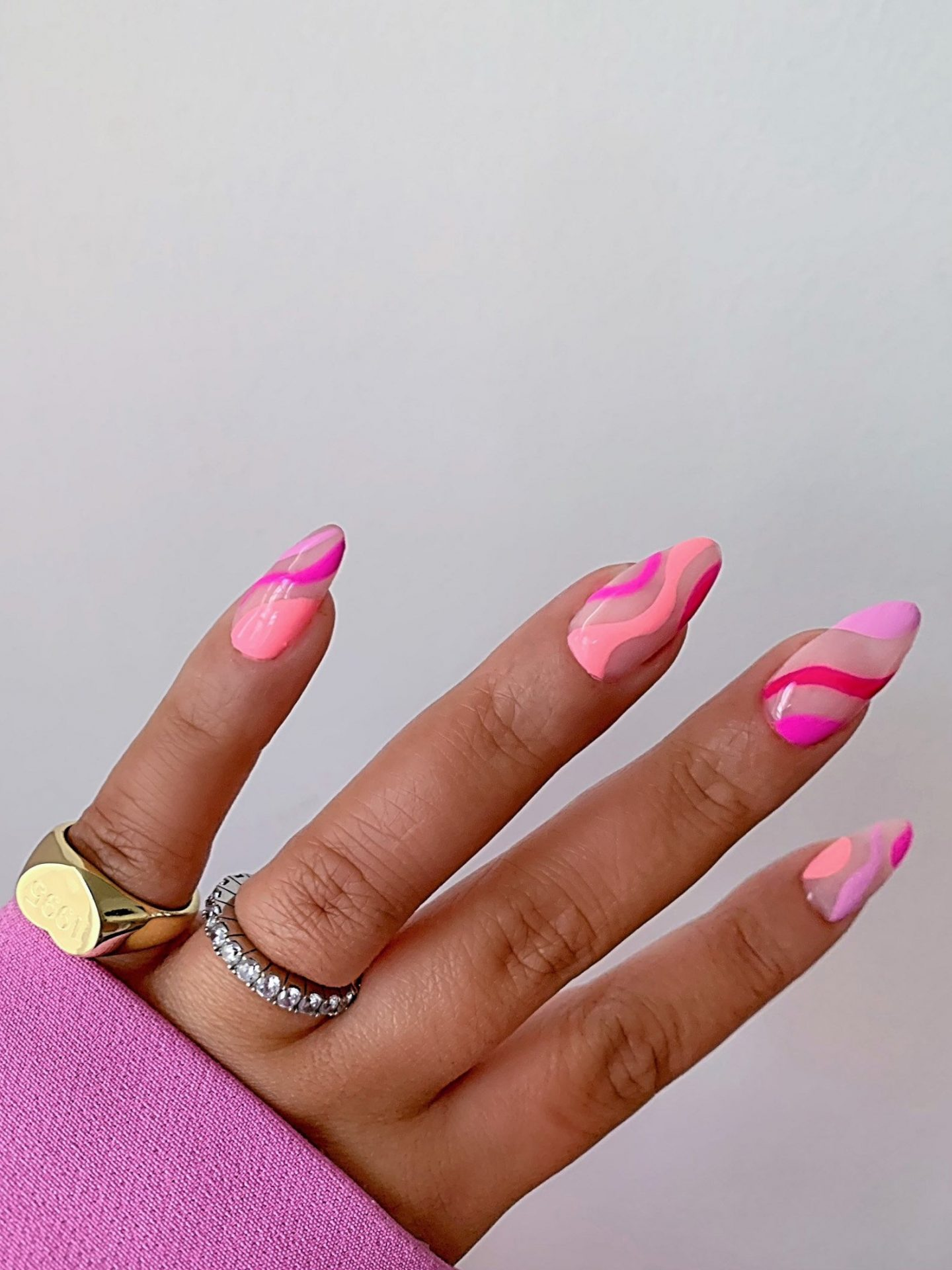 Neon pink abstract nails with swirls