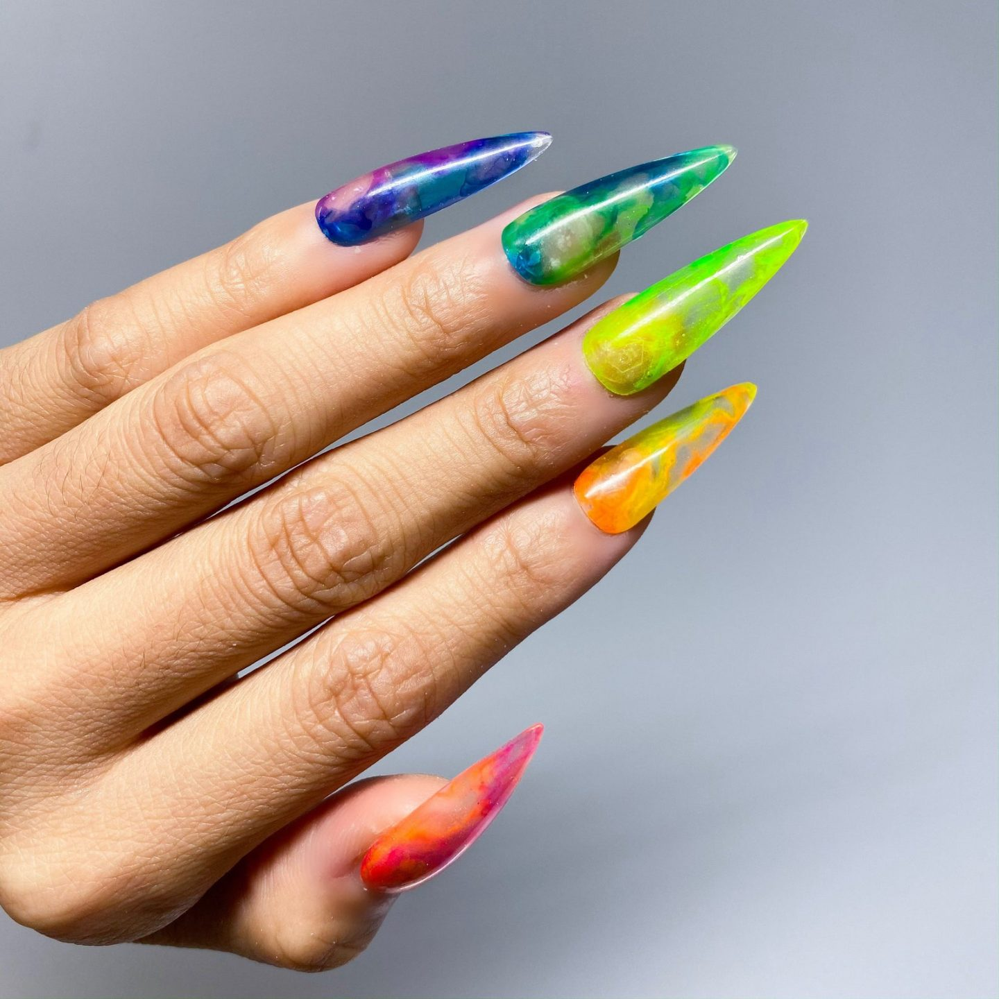 Rainbow nails in jelly effect and stiletto shape