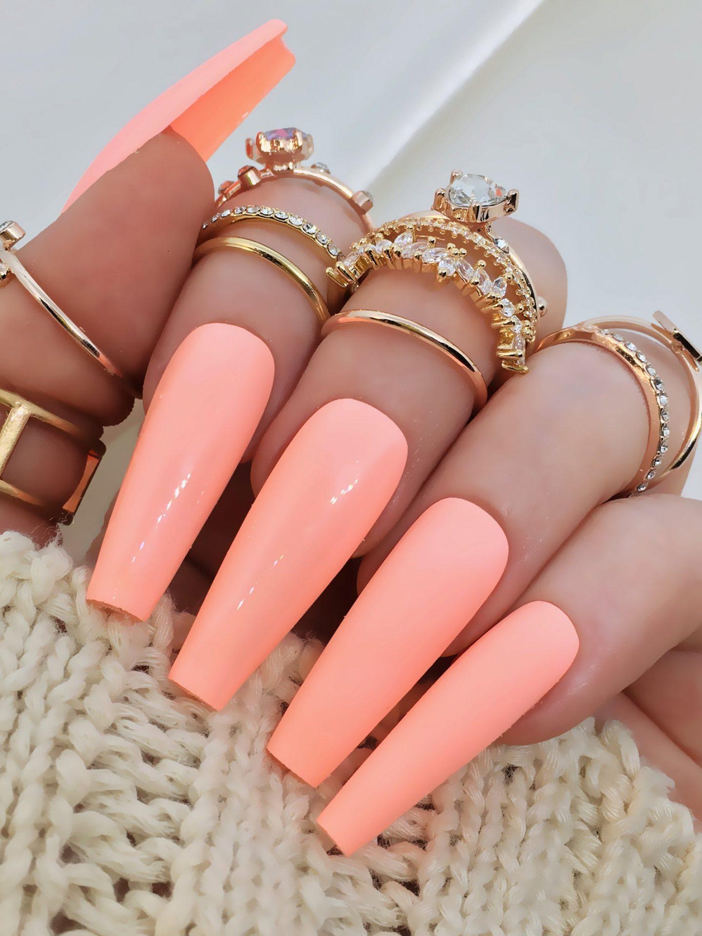 Pastel orange coffin nails for summer