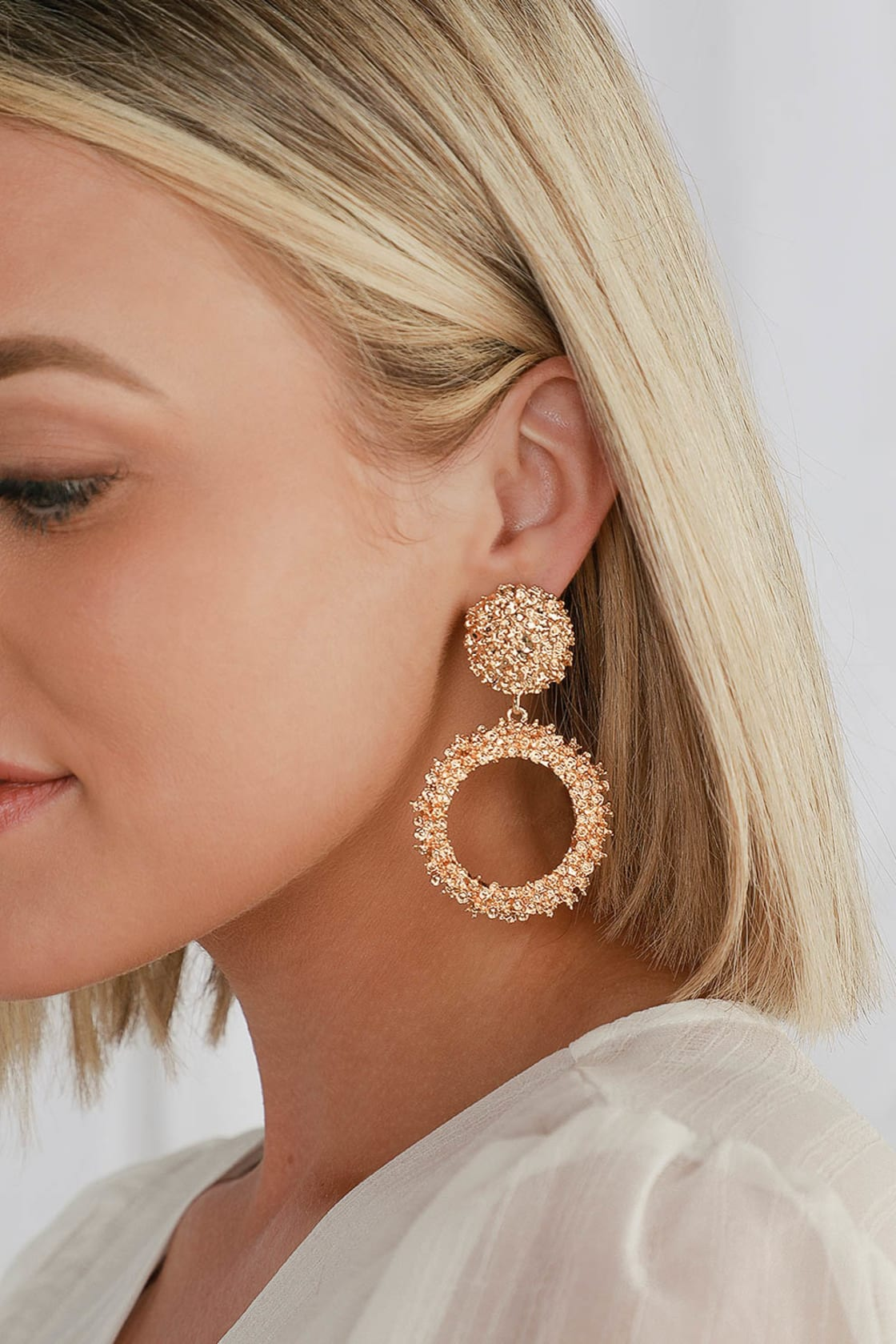 Gold statement earrings for summer