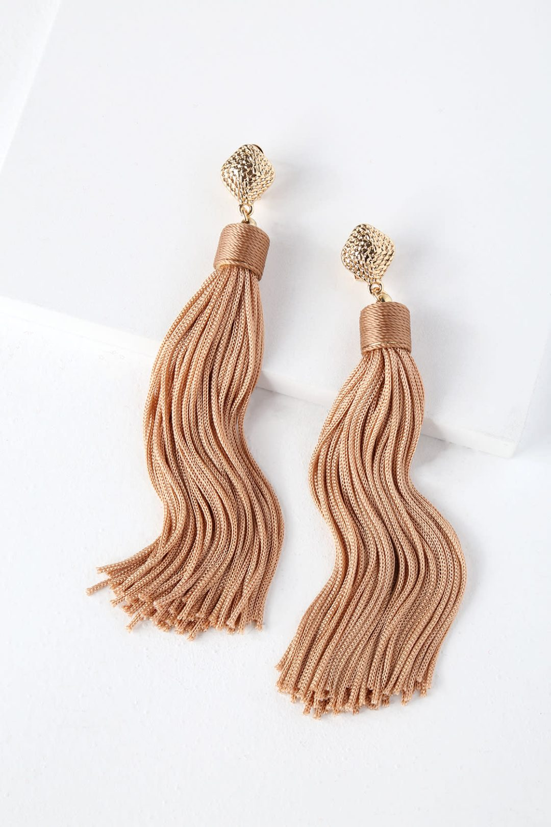 Gold beige tassel statement earrings