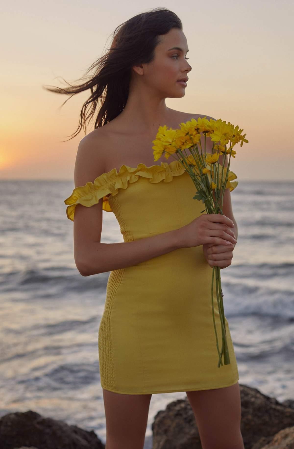 Short yellow summer dress with ruffle hem