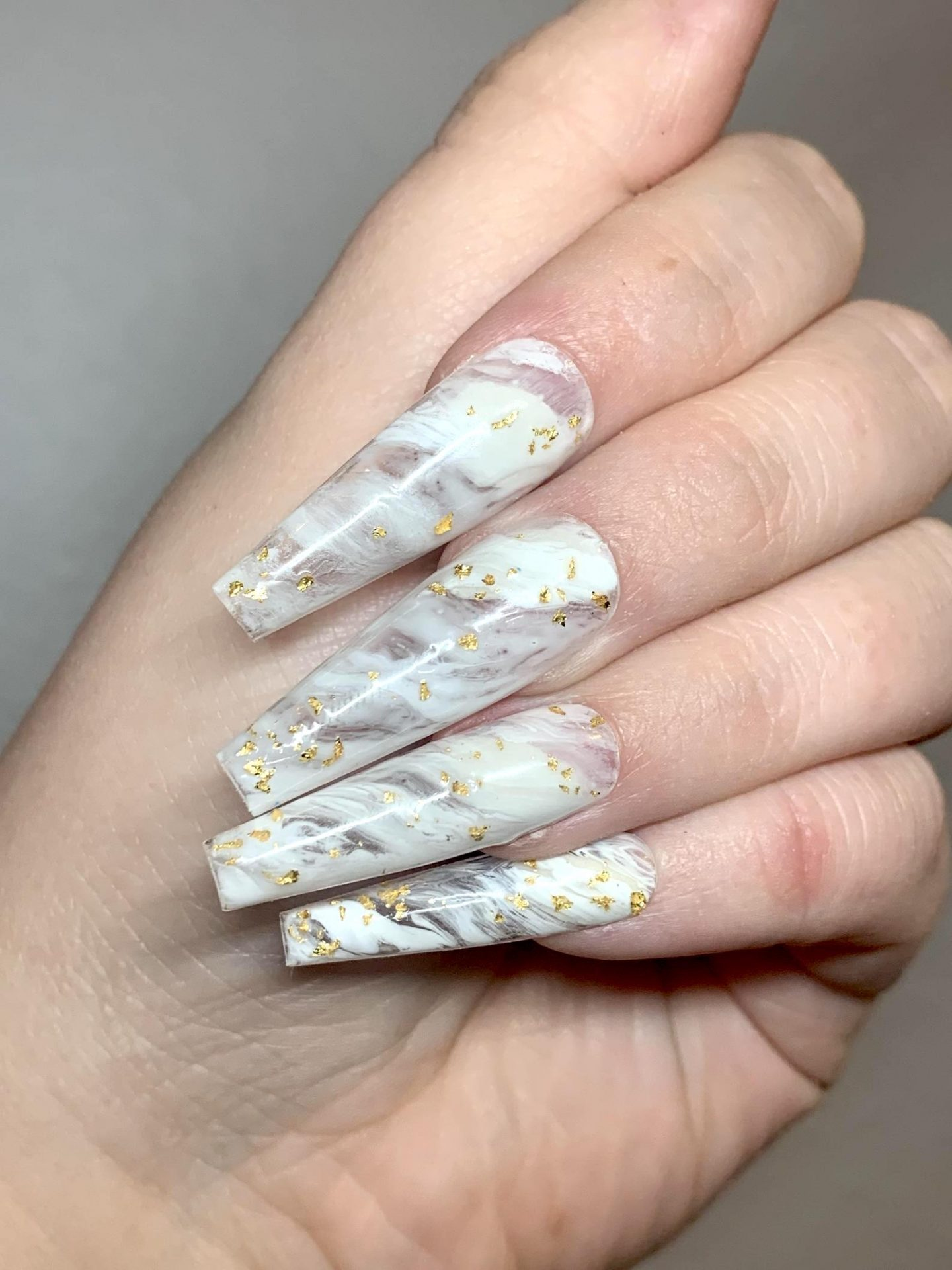 Long white marble nails with gold foil