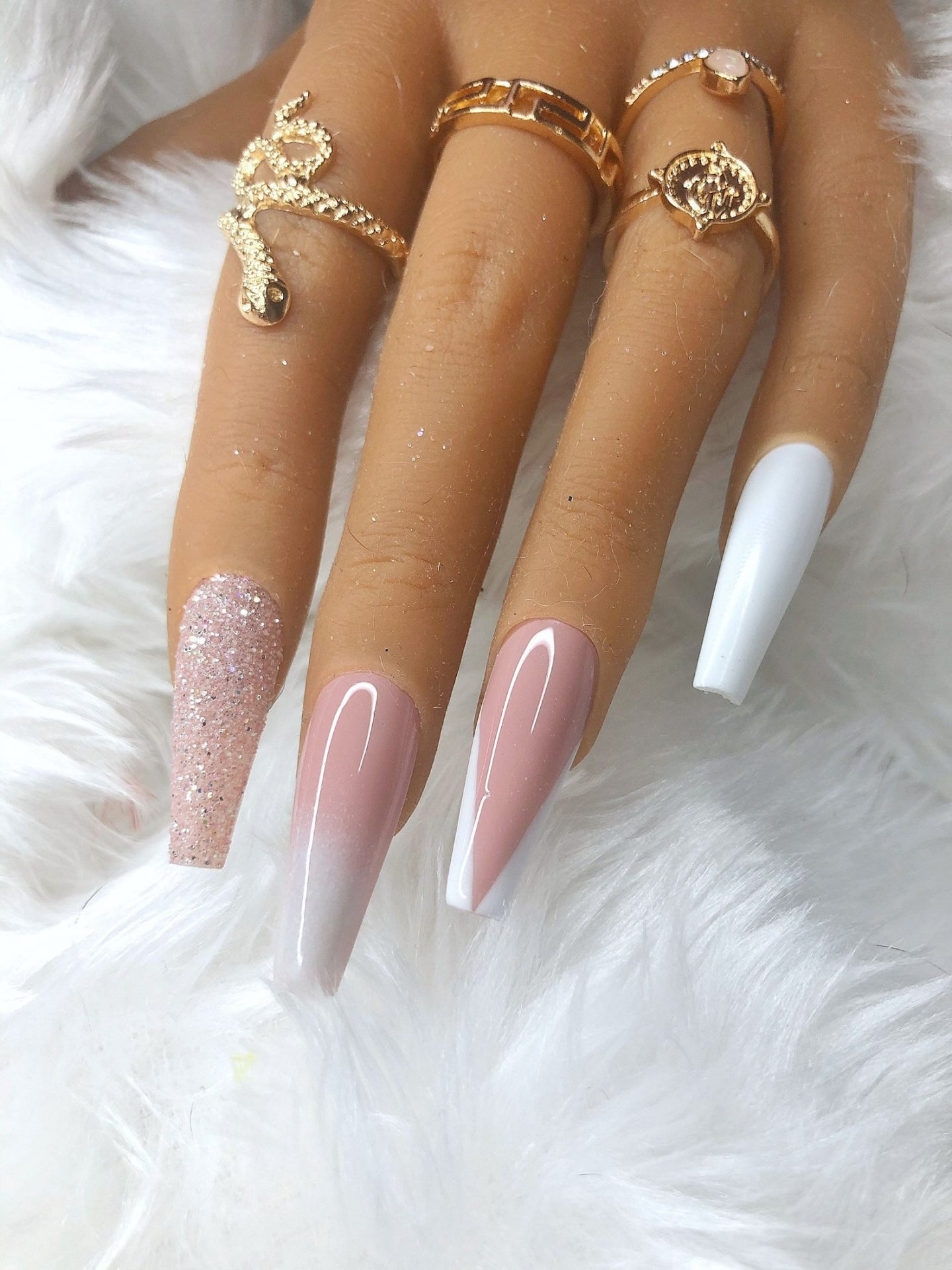 Cute pink and white French tip nails with glitter