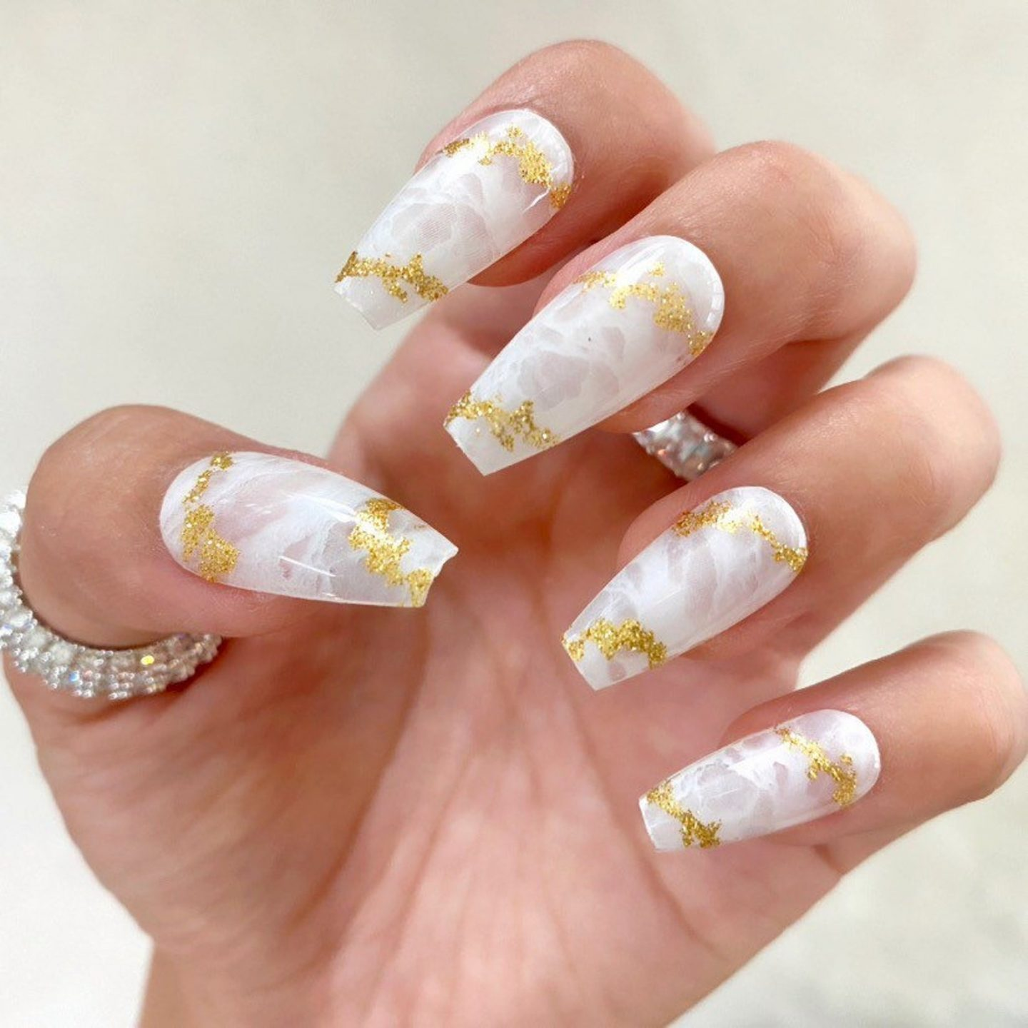 White marble coffin nails with gold foil