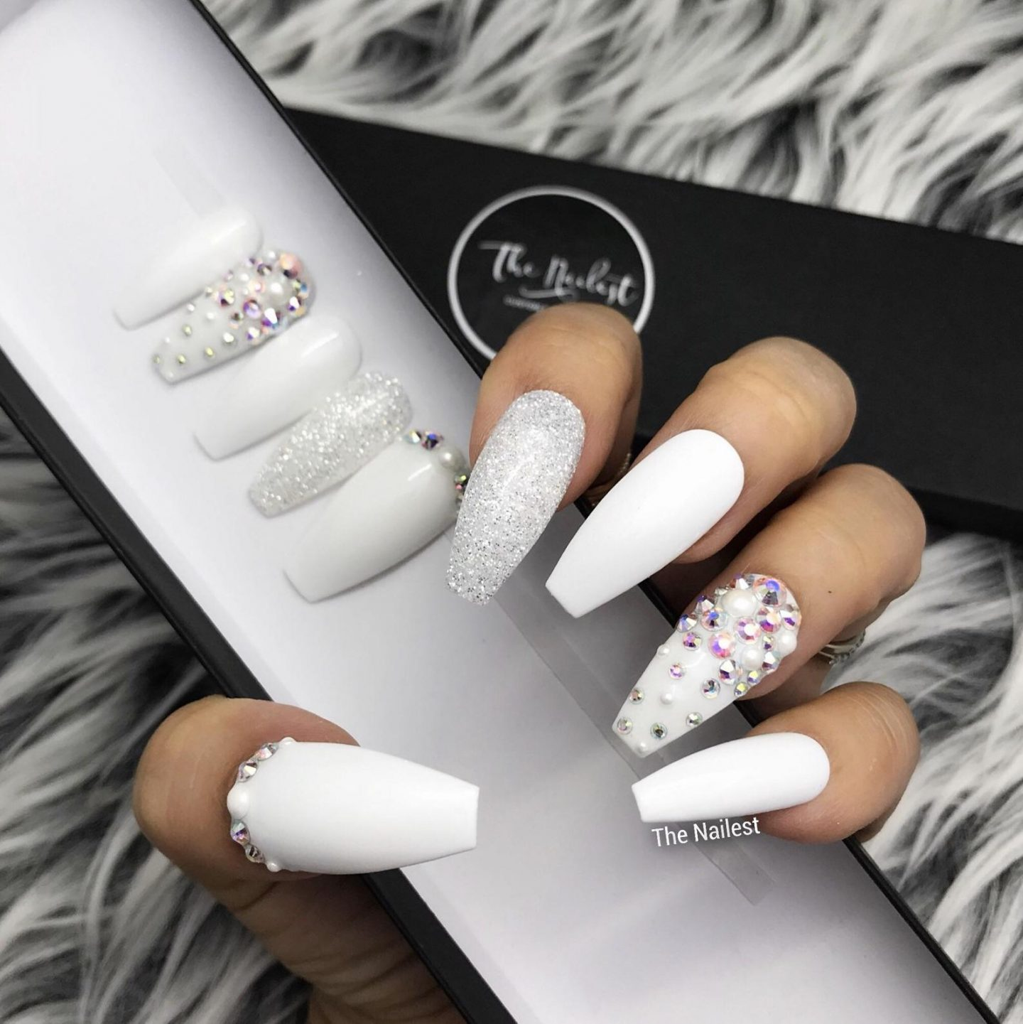 Long white coffin nails with glitter and rhinestones