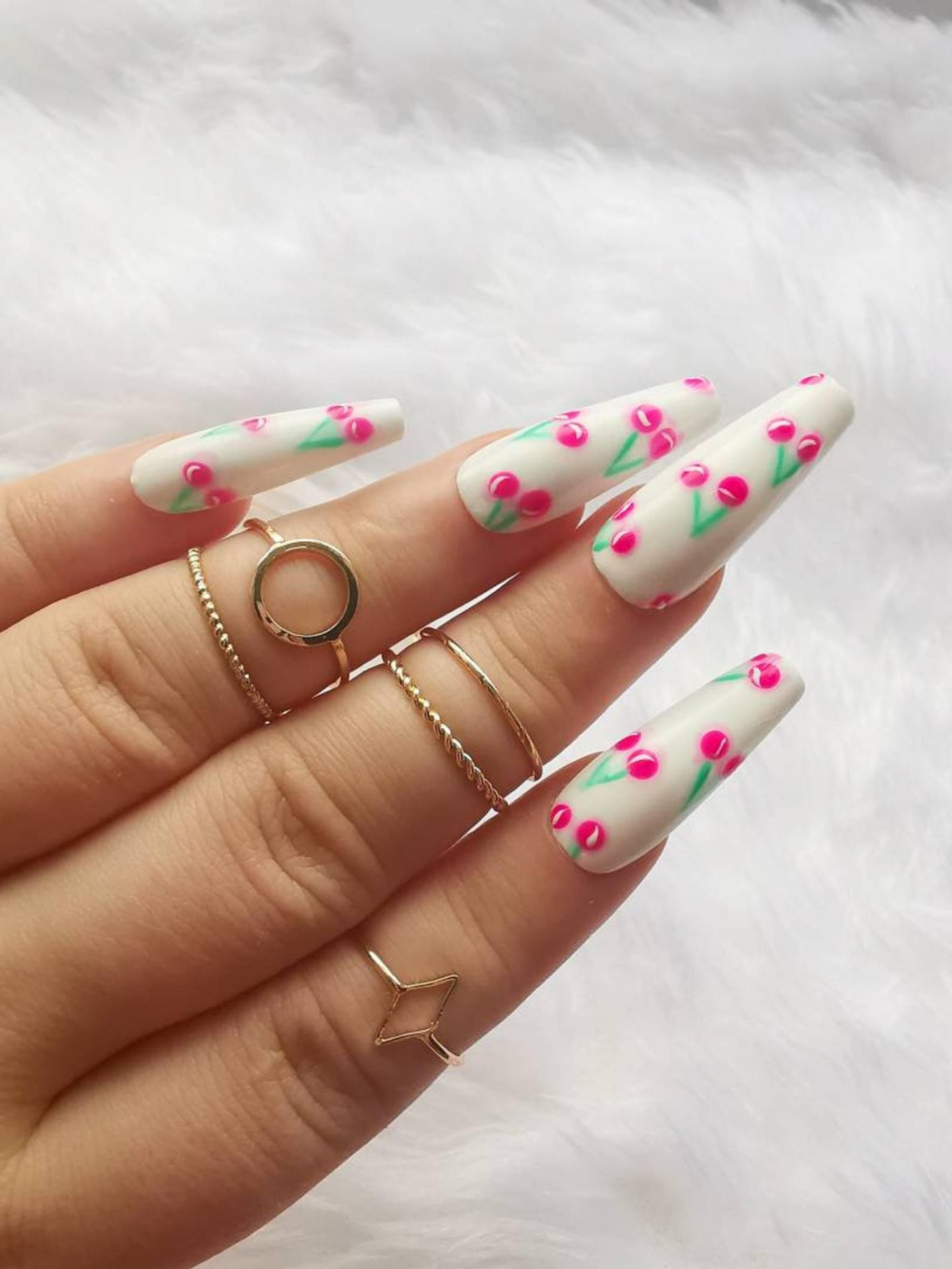 Long white nails with cherry nail art