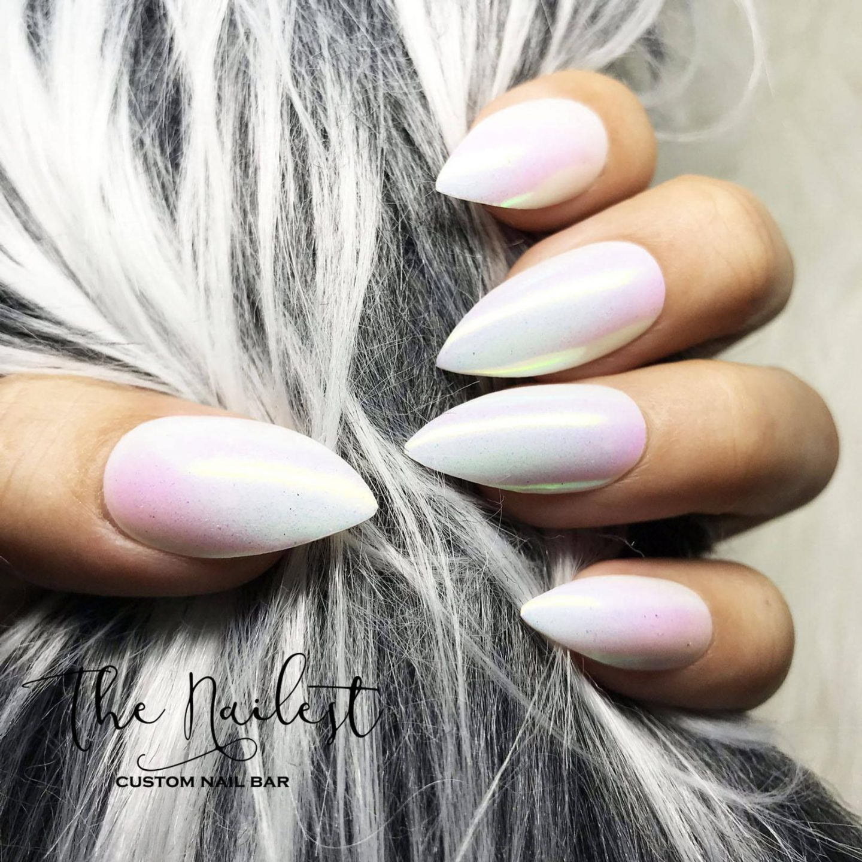 Holographic white unicorn nails in stiletto shape