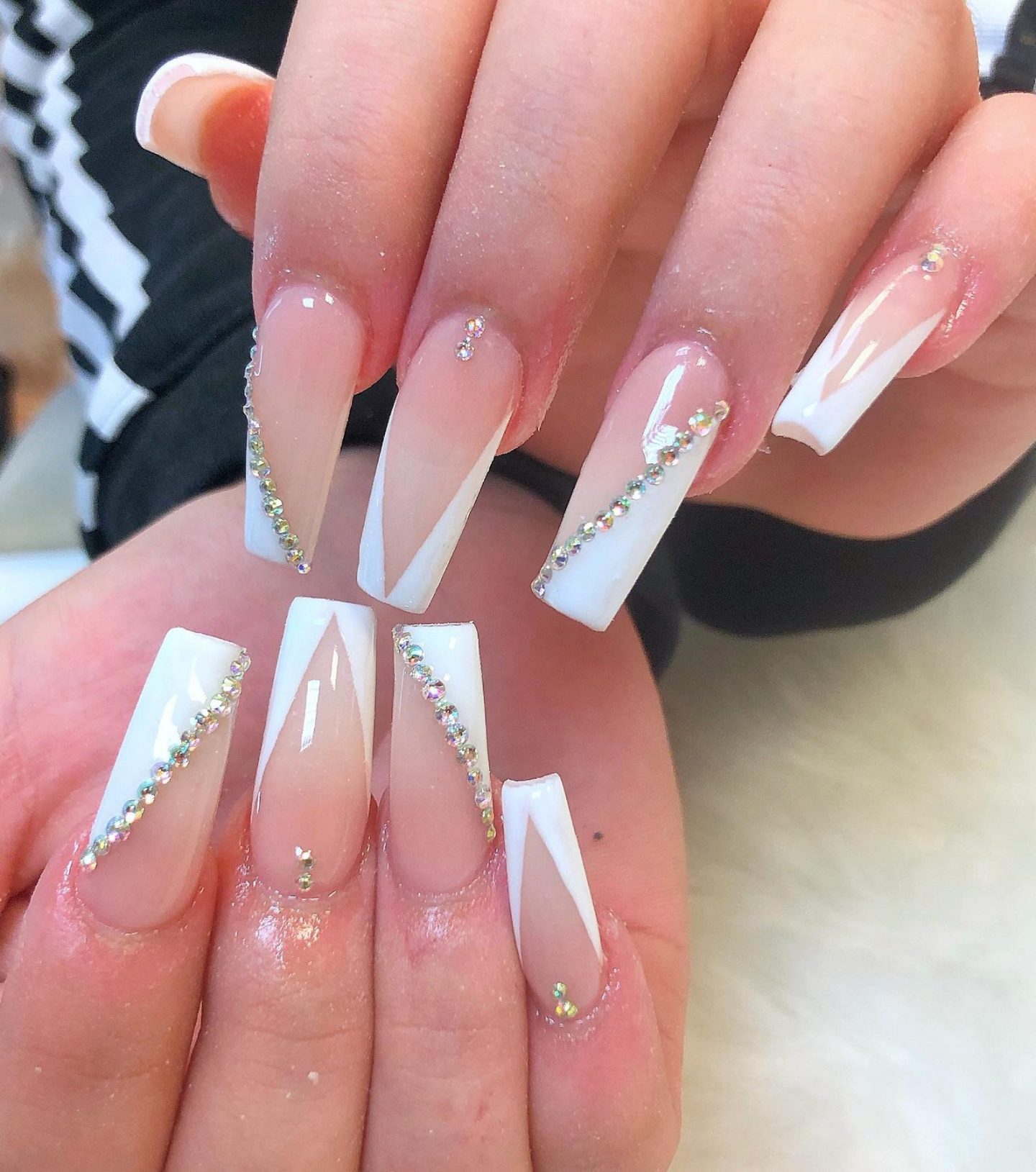 Modern French tip nails with whinestones