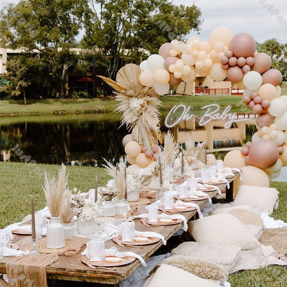 Cream and rose gold balloon garland arch for parties