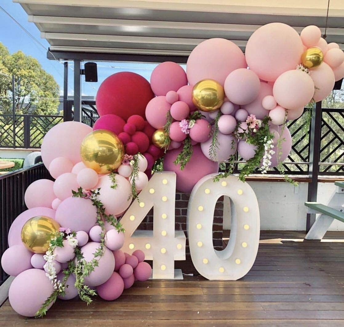Ombre matte pink balloon garland with number sign