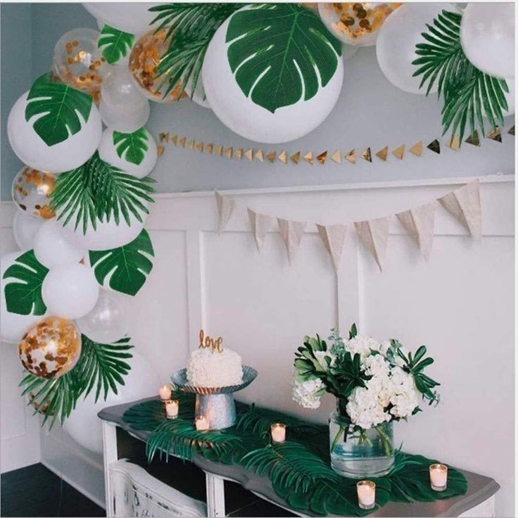 Safari themed birthday party decorations with monstera leaves