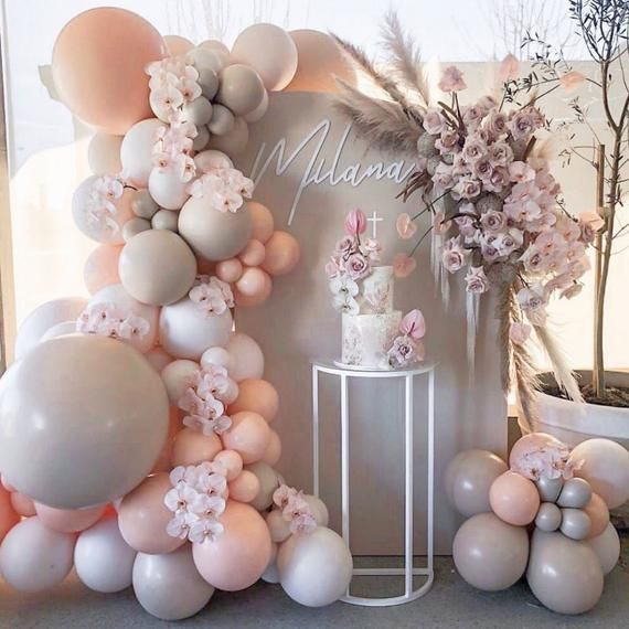 Ombre cream and pink balloon birdthay party decorations