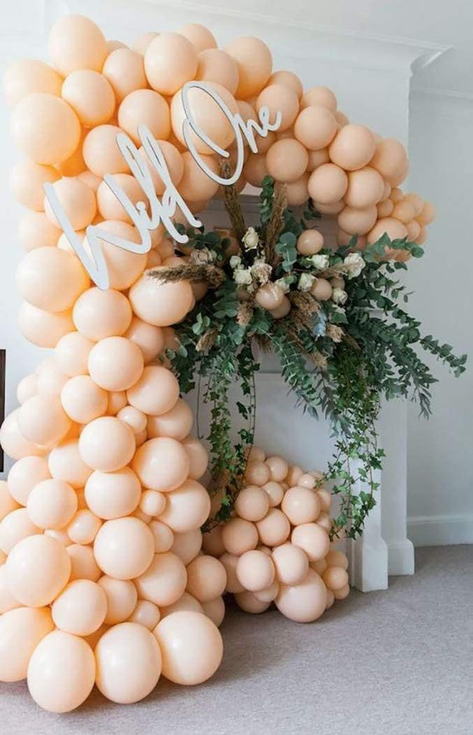 Matte peach balloon garland arch for birthdays