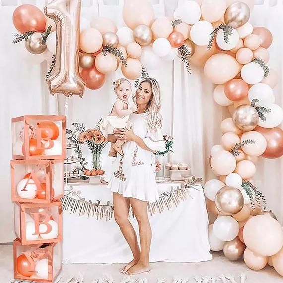 Rose gold band pink balloon garland arch with pink BABY boxes