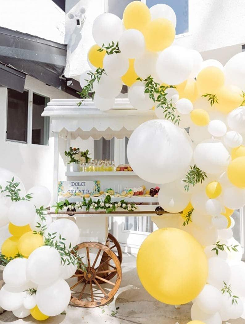 White and yellow birthday party balloons