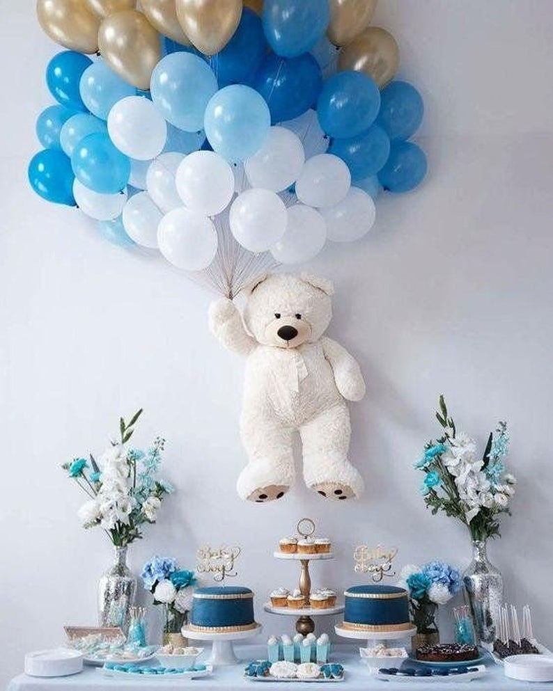 Ombre blue and gold balloons with teddy for baby shower