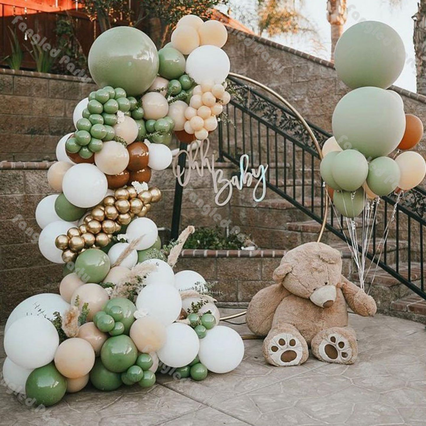 Green, white and gold baby shower balloon garland arch with teddy bear