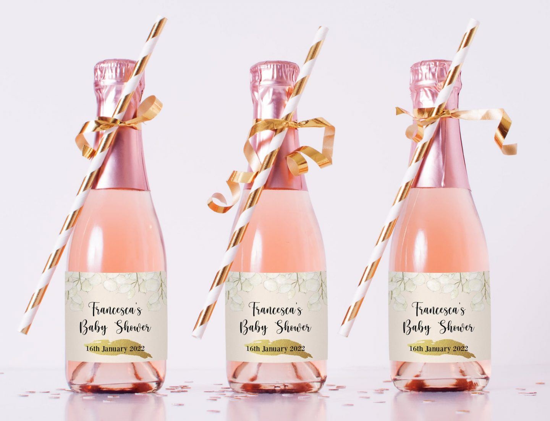 Custom pink baby shower favors in champagne bottle