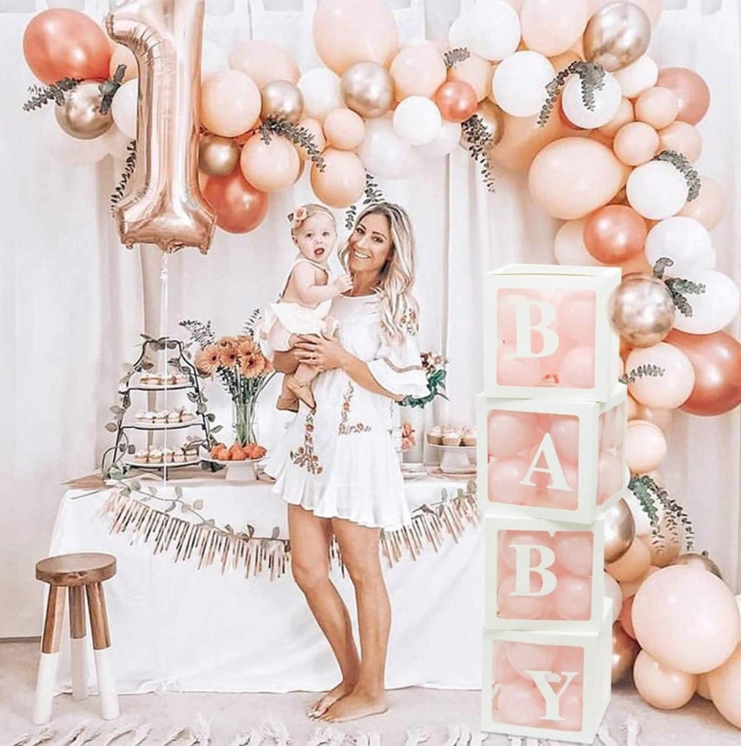 Pink and rose gold baby shower decorations with balloons