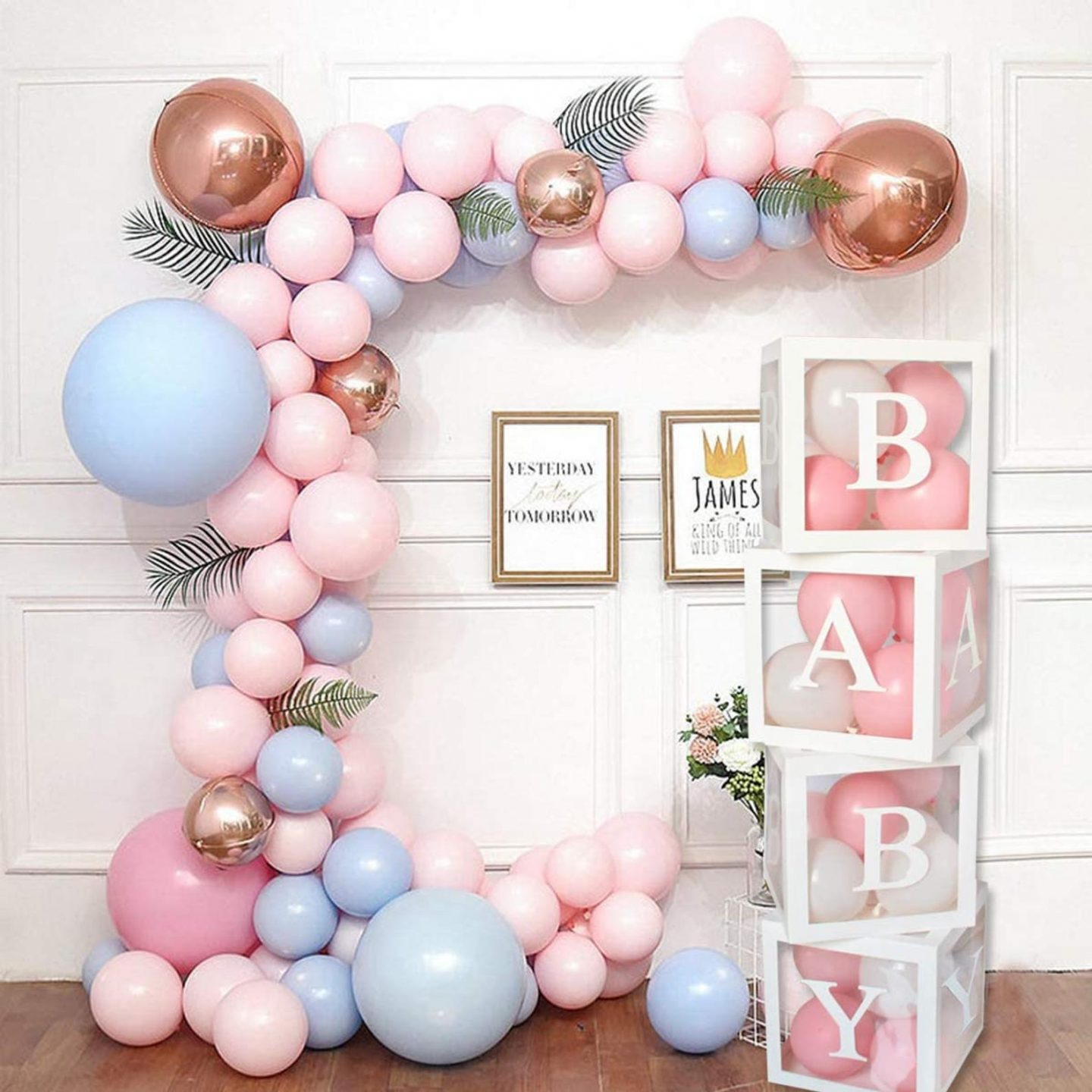 Pink and blue baby shower balloons and transparent boxes