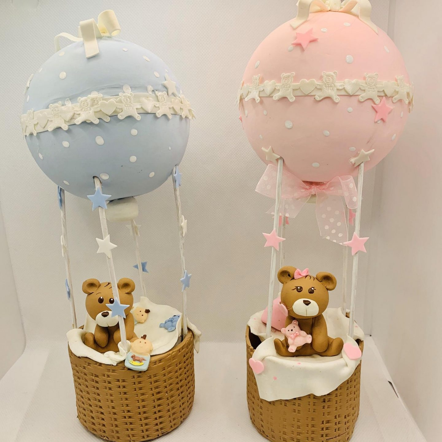 Pink and blue baby shower centerpiece or cake topper