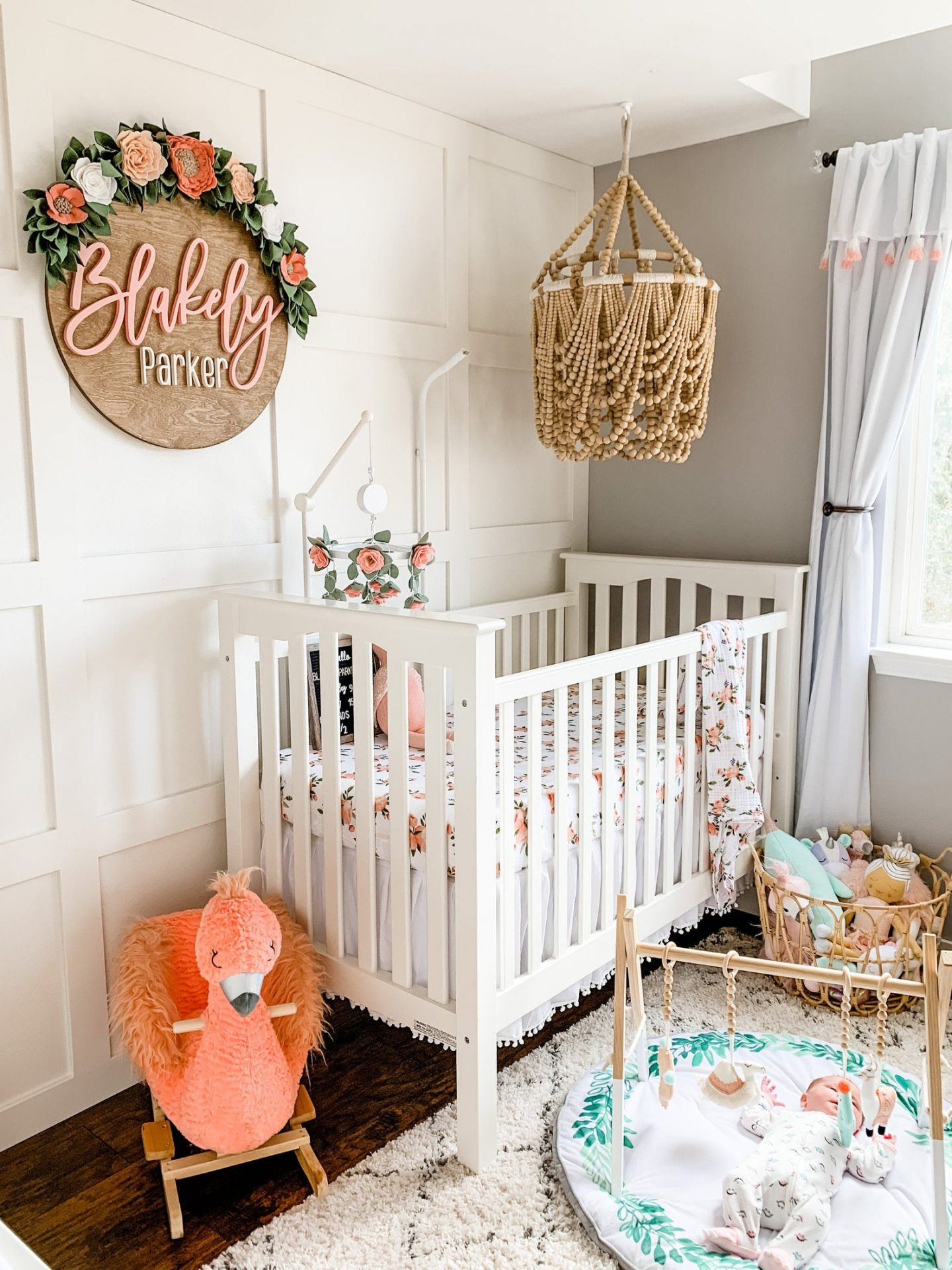 Floral and wooden personalized nursery name sign