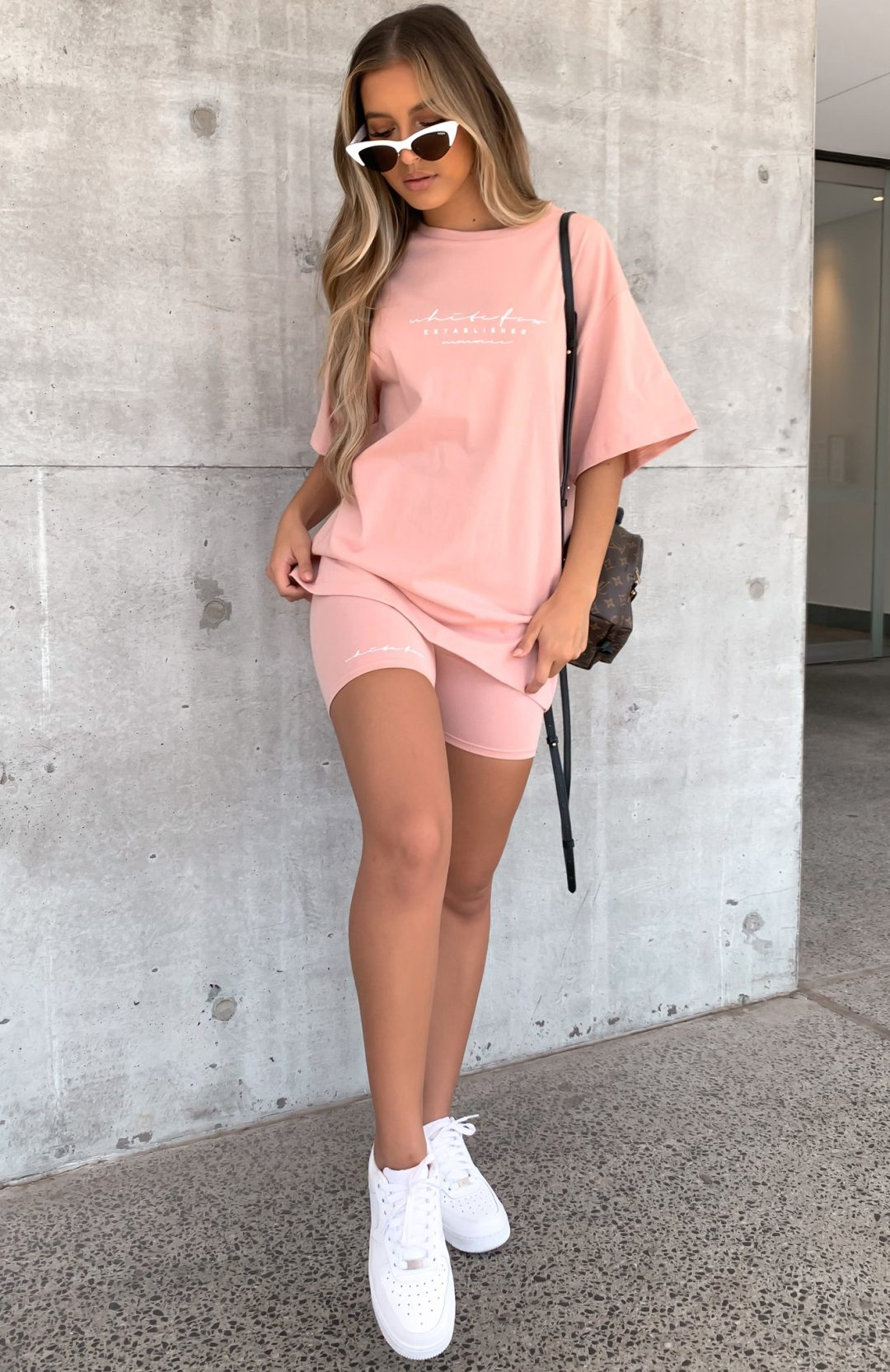 Matching light pink biker shorts outfit for airport