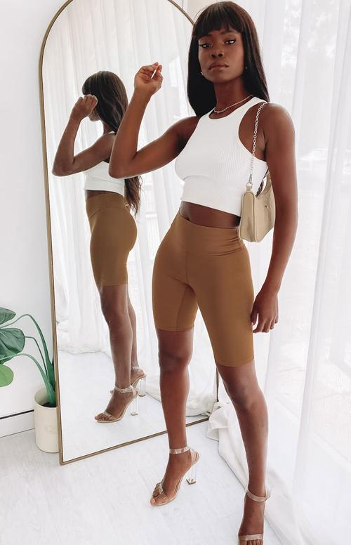 Brown bike shorts outfit with white crop top