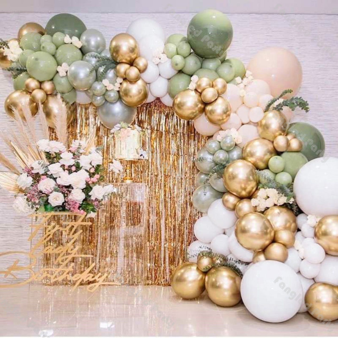 White, gold and sage green birthday party balloons with gold fringe curtain