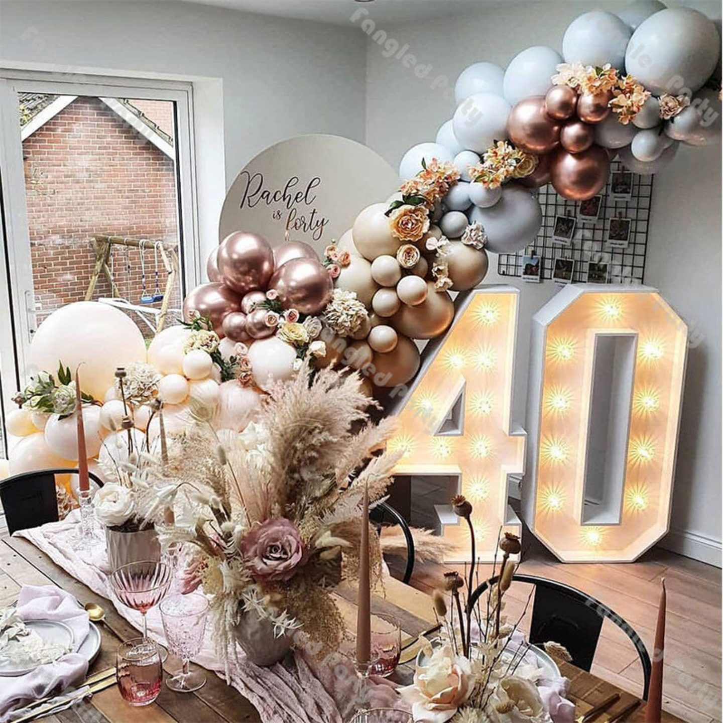 Rose gold birthday party decorations with balloon garland and dried flowers for 40th birthday