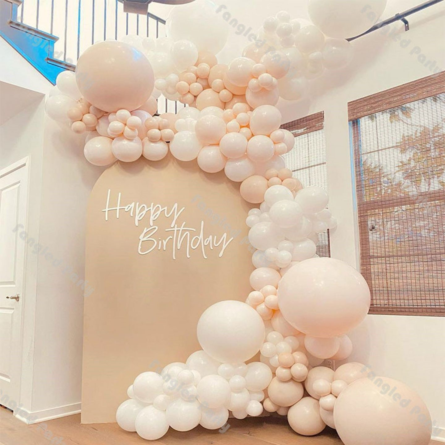 White and light peach balloon garland arch for birthday parties
